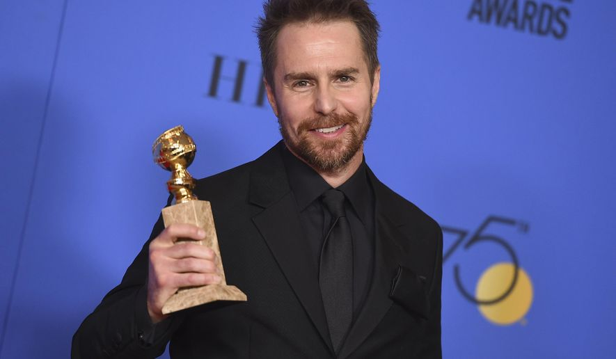 """FILE- In this Jan. 7, 2018, file photo, Sam Rockwell poses in the press room with the award for best performance by an actor in a supporting role in any motion picture for """"Three Billboards Outside Ebbing, Missouri"""" at the 75th annual Golden Globe Awards at the Beverly Hilton Hotel in Beverly Hills, Calif.  On """"Saturday Night Live,"""" guest host Rockwell let an expletive slip during a skit on Saturday, Jan. 13, 2018. He then put his hand to his mouth and said """"sorry"""" before continuing with the skit. (Photo by Jordan Strauss/Invision/AP, File)"""