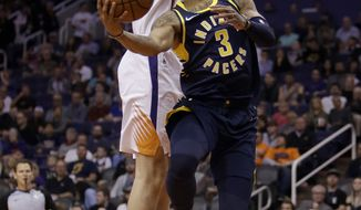 Indiana Pacers guard Joe Young (3) drives past Phoenix Suns forward Dragan Bender in the first half during an NBA basketball game, Sunday, Jan. 14, 2018, in Phoenix. (AP Photo/Rick Scuteri)
