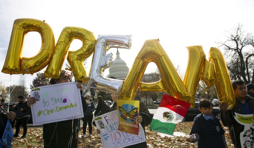 """FILE - In this Dec. 6, 2017, file photo, demonstrators hold up balloons during an immigration rally in support of the Deferred Action for Childhood Arrivals (DACA), and Temporary Protected Status (TPS), programs, near the U.S. Capitol in Washington. Casting a cloud over already tenuous negotiations, President Donald Trump said Sunday, Jan. 14, 2018, that DACA, a program that protects immigrants who were brought to the U.S. as children and live here illegally, is """"probably dead"""" and blamed Democrats, days before some government functions would start shutting down unless a deal is reached. (AP Photo/Jose Luis Magana, File)"""