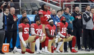 The San Francisco 49ers, who did not qualify for the NFL postseason, had only four players taking a knee during the national anthem by Week 17. Kneeling at Week 16 were (from left) Eli Harold, Eric Reid, Marquise Goodwin and Louis Murphy. (Associated Press/File)