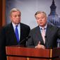 Sen. Richard J. Durbin (left), Illinois Democrat, and Sen. Lindsey Graham, South Carolina Republican, are pressuring President Trump to accept their proposed 12-year pathway to citizenship for Dreamers. (Associated Press/File)