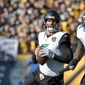 Jacksonville Jaguars quarterback Blake Bortles (5) plays in an NFL football game against the Pittsburgh Steelers, Sunday, Jan. 14, 2018, in Pittsburgh. (AP Photo/Don Wright)