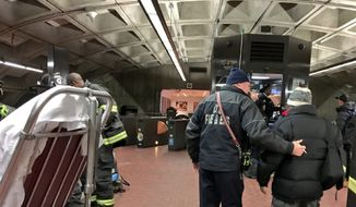 Emergency crews evacuate a Metro train that had derailed Monday, Jan. 15, 2018, in Washington, D.C. There were no injuries or fire. (Image courtesy D.C. Fire and EMS Twitter)