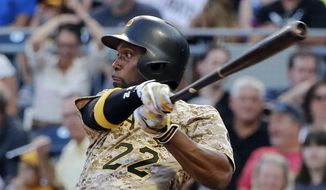 FILE - In this Aug. 3, 2017, file photo, Pittsburgh Pirates' Andrew McCutchen watches his RBI-single off Cincinnati Reds starting pitcher Sal Romano during the third inning of a baseball game in Pittsburgh. The Giants acquired McCutchen from the Pirates for right-hander Kyle Crick, minor league outfielder Bryan Reynolds and $500,000 in international signing bonus allocation. (AP Photo/Gene J. Puskar, File) **FILE**