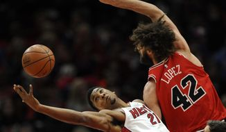 Miami Heat's Hassan Whiteside (21) battles Chicago Bulls' Robin Lopez (42) for a rebound during the first half of an NBA basketball game Monday, Jan. 15, 2018, in Chicago. (AP Photo/Paul Beaty)