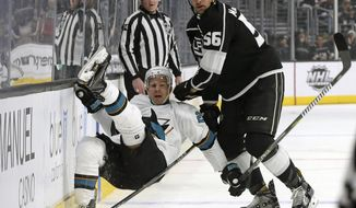 San Jose Sharks rignt winger Joonas Donskoi (27) and Los Angeles Kings defenseman Kurtis MacDermid (56) tangle in the first period of an NHL hockey game in Los Angeles, Monday, Jan. 15, 2018. (AP Photo/Reed Saxon)
