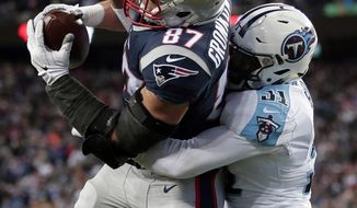 New England Patriots tight end Rob Gronkowski catches a touchdown pass with Tennessee Titans safety Kevin Byard (31) defending during the second half of an NFL divisional playoff football game, Saturday, Jan. 13, 2018, in Foxborough, Mass. (AP Photo/Steven Senne)
