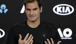 Switzerland's Roger Federer answers questions during a press conference at the Australian Open tennis championships in Melbourne, Australia, Sunday, Jan. 14, 2018. (AP Photo/Dita Alangkara)
