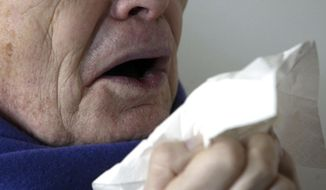 FILE - In this Jan. 14, 2005 file photo, a man sneezes holding a tissue in Berlin, Germany. According to a case study published Monday, Jan. 15, 2018, in the journal BMJ Case Reports, doctors in England say stifling a big sneeze can be hazardous for your health in rare cases, based on the very unusual experience of a man who ruptured the back of his throat when he tried to stop a sneeze. (AP Photo/Roberto Pfeil, File)