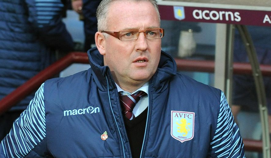 FILE - In this file photo dated Sunday, Nov. 2, 2014, Aston Villa manager Paul Lambert during the English Premier League soccer match against Tottenham Hotspur at Villa Park in Birmingham, England.  Stoke has hired Paul Lambert to manage the Premier League club, according to an announcement Monday Jan. 15, 2018. (AP Photo/Rui Vieira, FILE)