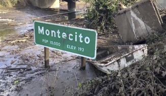 In this Monday, Jan. 15, 2018 image from video provided by the Santa Barbara County Fire Department, the U.S. 101 freeway remains underwater as clean-up crews work to clear the roads throughout Montecito, Calif., following the deadly mudflow and flooding Jan. 9. Crews working around the clock cleared boulders, trees and crushed cars from all lanes of U.S. 101, but California officials still weren't sure Monday when the key coastal highway might reopen after being inundated during mudslides that killed 20 people. (Mike Eliason/Santa Barbara County Fire Department via AP)
