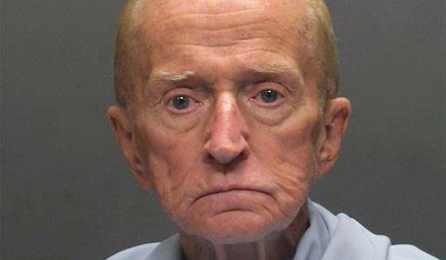 This Sunday, Jan. 15, 2018 photo released by the Tucson Police Department shows suspect Robert Francis Krebs, an 80-year-old man they say robbed a credit union at gunpoint. Police announced Sunday that a tip led to the arrest of Krebs after police circulated surveillance photos of him entering the Pyramid Credit Union and at a teller's window. They say Krebs had a handgun, demanded money from the teller and was given cash before running out of the bank. (Tucson Police Department via AP)