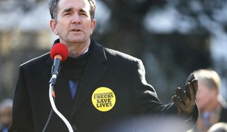 Virginia Gov. Ralph Northam gestures as he addresses an anti-gun violence rally at the Capitol in Richmond, Va., Monday, Jan. 15, 2018. (AP Photo/Steve Helber)