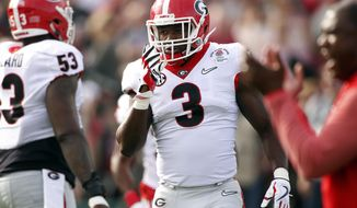 FILE - In this Monday, Jan. 1, 2018, file photo, Georgia linebacker Roquan Smith (3) during warm ups before the start Rose Bowl NCAA college football game against Oklahoma in Pasadena, Calif. Smith, the leader of a defense that led Georgia to the national championship game, is entering the NFL draft.(Joshua L. Jones/Athens Banner-Herald via AP, File)
