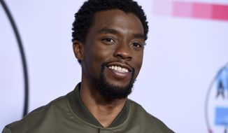 """FILE - In this Sunday, Nov. 19, 2017 file photo, Chadwick Boseman arrives at the American Music Awards at the Microsoft Theater in Los Angeles. Mary J. Blige, Sterling K. Brown, Issa Rae and Boseman will be among the presenters at the upcoming NAACP Image Awards. Numerous other stars, including actors Michael B. Jordan, Terry Crews, Yara Shahidi and """"Get Out"""" star Daniel Kaluuya are also scheduled to present during the ceremony, Monday, Jan. 15, 2018, which honors entertainers and writers of color. (Photo by Jordan Strauss/Invision/AP, File)"""