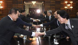 In this photo provided by South Korea Unification Ministry, South Korean delegation, right, shakes hands with North Korean delegation, left, for their meeting at the North side of Panmunjom in North Korea, Monday, Jan. 15, 2018. Officials from the Koreas met Monday to work out details about North Korea's plan to send an art troupe to the South during next month's Winter Olympics, as the rivals tried to follow up on the North's recent agreement to cooperate in the Games in a conciliatory gesture following months of nuclear tensions. (South Korea Unification Ministry via AP)