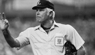 FILE- In this Oct. 11, 1980, file photo, plate umpire Doug Harvey gestures before play resumes in the fourth inning of a baseball game between the Astros and Phillies in Houston. Harvey, one of 10 umpires enshrined in the baseball Hall of Fame, died Saturday, Jan. 13, 2018. He was 87. (AP Photo/Brian Horton, File)