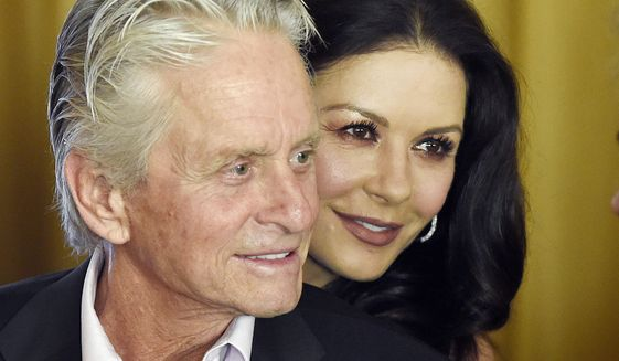 In this Dec. 9. 2016, file photo, actor Michael Douglas and his wife, actress Catherine Zeta-Jones, attend a party at the Beverly Hills Hotel in Beverly Hills, Calif. (Photo by Chris Pizzello/Invision/AP, File)