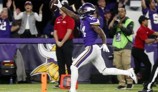Minnesota Vikings wide receiver Stefon Diggs (14) runs in for a game winning touchdown against the New Orleans Saints during the second half of an NFL divisional football playoff game in Minneapolis, Sunday, Jan. 14, 2018. The Vikings defeated the Saints 29-24. (AP Photo/Jim Mone)