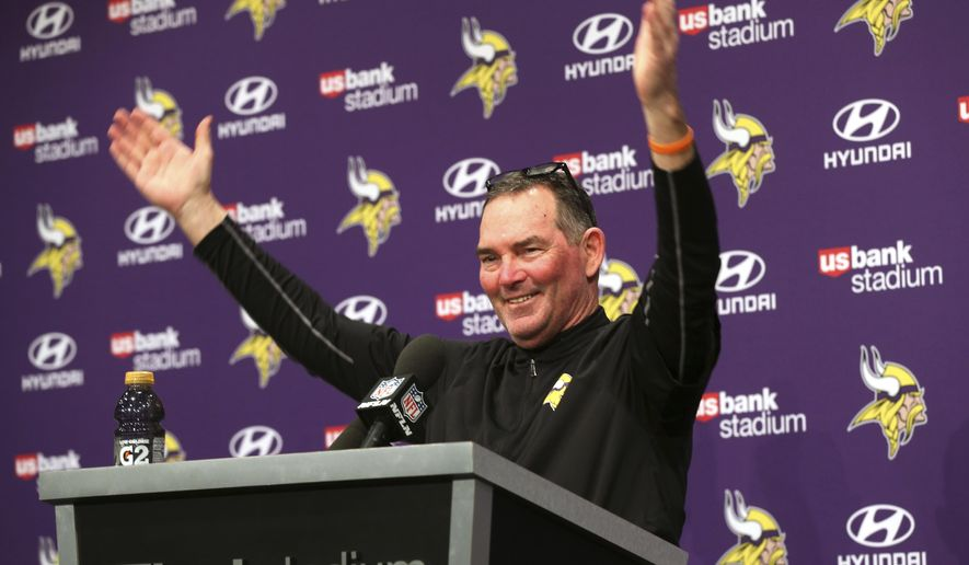 Minnesota Vikings head coach Mike Zimmer waves as fans looked into his post-game press conference following a 29-24 win over the New Orleans Saints an NFL divisional football playoff game in Minneapolis, Sunday, Jan. 14, 2018. (AP Photo/Jim Mone)