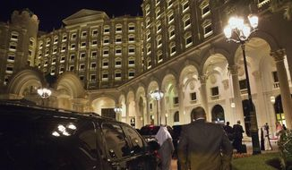 FILE - In this Jan. 23, 2016 file photo, the motorcade carrying then U.S. Secretary of State John Kerry arrives at the Ritz Carlton Hotel in Riyadh, Saudi Arabia. The Ritz Carlton in Saudi Arabia's capital may be reopening its doors in times for Valentine's Day 2018 after serving as a prison for the country's elite caught up in what the government has described as a crackdown on corruption. The hotel's website on Monday, Jan 15, 2018 showed bookings available beginning from Feb. 14. (AP Photo/Jacquelyn Martin, Pool, File)
