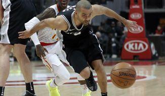 San Antonio Spurs guard Tony Parker (9) and Atlanta Hawks guard Dennis Schroder (17) chase down a loose ball in the first half of an NBA basketball game Monday, Jan. 15, 2018, in Atlanta. (AP Photo/John Bazemore)
