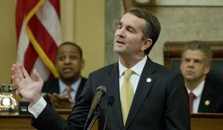 Virginia Gov. Ralph Northam gestures as he delivers his State of the Commonwealth address before a joint session of the Virginia General Assembly as Lt. gov. Justin Fairfax, left, and House Speaker Kirk cox, R-Colonial Heights, right, listen at the Capitol in Richmond, Va., Monday, Jan. 15, 2018. (AP Photo/Steve Helber) ** FILE **