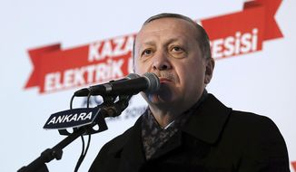 "Turkey's President Recep Tayyip Erdogan speaks at an event in Ankara, Turkey, Monday, Jan. 15, 2018.   Erdogan accused its NATO ally, the United States of forming a ""terrorist force"" at Turkey's border, and vowed to ""drown"" the new 30,000-strong border security force. (Yasin Bulbul/Pool Photo via AP )"