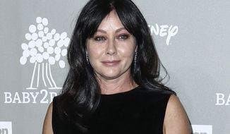 "FILE - In this Nov. 14, 2015 file photo, Shannen Doherty attends the 4th Annual Baby2Baby Gala in Culver City, Calif. The 1988 movie ""Heathers,"" which starred Doherty, will be adapted for TV. Doherty, who played Heather Duke in the movie, will guest star in the first episode.  (Photo by John Salangsang/Invision/AP, File)"