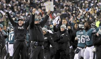 FILE - In this Saturday, Jan. 13, 2018, file photo, Philadelphia Eagles coach Doug Pederson, center, celebrates a defensive stop on fourth down in the second half of an NFL divisional playoff football game against the Atlanta Falcons in Philadelphia. The Eagles are home underdogs again in the NFC championship game against Case Keenum and the Minnesota Vikings.(AP Photo/Chris Szagola, File) **FILE**