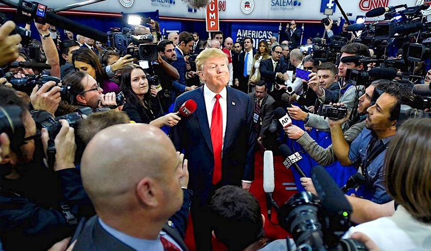 An aggressive press has been around for a while. Here, then-presidential hopeful Donald Trump faces a wall of journalists on the 2016 campaign trail. The relationship hasn't improved at all. (Associated Press)