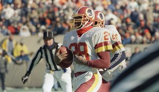 Washington Redskins Darrell Green (28) scores a touchdown on a third quarter punt return against the Bears in Chicago, Sunday, Jan. 10, 1988. Washington won, 21-17. (AP Photo/Fred Jewell) **FILE**
