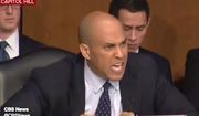 """Sen. Cory Booker harangues Homeland Security Secretary Kristjen Nielsen about President Trump's rhetoric, Jan. 16, 2018. The New Jersey Democrat told members of the Senate Judiciary Committee that he recently had """"tears of rage"""" in his eyes over remarks attributed to Mr. Trump. (Image: CBS News screenshot)"""