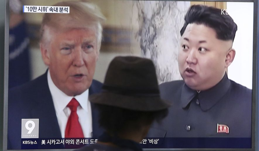 """In this Aug. 10, 2017, photo, a man watches a television screen showing U.S. President Donald Trump and North Korean leader Kim Jong Un during a news program at the Seoul Train Station in Seoul, South Korea. North Korea's state-run media say U.S. President Donald Trump's tweet about having a bigger nuclear button than Kim Jong Un's is the """"spasm of a lunatic."""" (AP Photo/Ahn Young-joon, File)"""