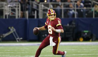 Washington Redskins quarterback Kirk Cousins (8) rolls out of the pocket to pass during an NFL football game against the Dallas Cowboys on Thursday, Nov. 30, 2017, in Arlington, Texas. (AP Photo/Roger Steinman) ** FILE **
