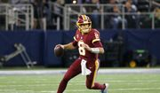 Washington Redskins quarterback Kirk Cousins (8) rolls out of the pocket to pass during an NFL football game against the Dallas Cowboys on Thursday, Nov. 30, 2017, in Arlington, Texas. (AP Photo/Roger Steinman)