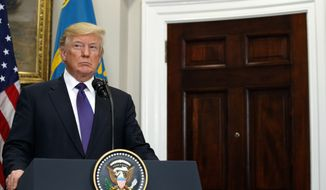 President Donald Trump listens to Kazakhstan's President Nursultan Nazarbayev in the Roosevelt Room of the White House, Tuesday, Jan. 16, 2018, in Washington. (AP Photo/Evan Vucci)