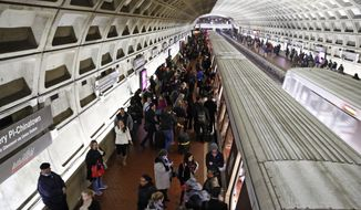 In this Jan. 11, 2018, photo, riders wait to board as others depart a Metro train in the Gallery Place-Chinatown Metro Station in Washington. Washington's Metro system has become internationally synonymous with delays, breakdowns and smoke-filled tunnels. (AP Photo/Alex Brandon) ** FILE **