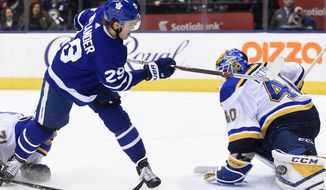 St. Louis Blues goaltender Carter Hutton (40) makes a save against Toronto Maple Leafs center William Nylander (29) on the breakaway during overtime of an NHL hockey game in Toronto on Tuesday, Jan. 16, 2018. St. Louis won, 2-1, in overtime. (Nathan Denette/The Canadian Press via AP)