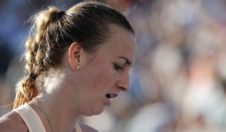 Petra Kvitova of the Czech Republic reacts while playing Germany's Andrea Petkovic during their first round match at the Australian Open tennis championships in Melbourne, Australia, Tuesday, Jan. 16, 2018. (AP Photo/Vincent Thian)