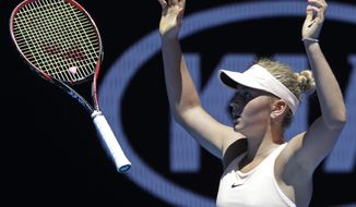 Ukraine's Marta Kostyuk celebrates after defeating Australia's Olivia Rogowska during their second round match at the Australian Open tennis championships in Melbourne, Australia, Wednesday, Jan. 17, 2018. (AP Photo/Dita Alangkara)