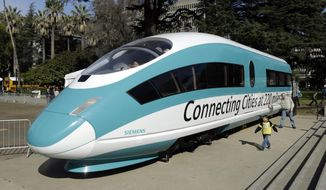 FILE - This Feb. 26, 2015, photo shows a full-scale mock-up of a high-speed train, displayed at the Capitol in Sacramento, Calif. Officials are raising the projected cost of the first phase of California's bullet train by 35 percent, to $10.6 billion. The extra $2.8 billion comes because of delays in obtaining rights of way and barriers along parts of the track a 199-mile segment in the Central Valley that is partly under construction. The California High Speed Rail Authority board discussed the increase Tuesday, Jan. 16, 2018. (AP Photo/Rich Pedroncelli, File)