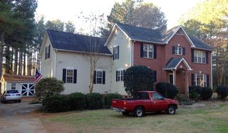 Cars are parked at a home in York, S.C. on Tuesday, Jan. 16, 2018, where multiple deputies responding to a domestic violence call were shot and wounded. State Law Enforcement Division spokesman Thom Berry said Christian Thomas McCall is the man officers think shot and wounded the officers early Tuesday. (AP Photo/Jeffrey S. Collins)