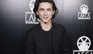 FILE - In this Jan. 13, 2018, file photo, Timothee Chalamet attends the 43rd Annual Los Angeles Film Critics Association Awards in Los Angeles. Chalamet said he will donate his salary for an upcoming Woody Allen film to charities fighting sexual harassment and abuse. (Photo by Richard Shotwell/Invision/AP)