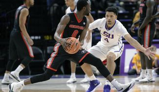LSU guard Skylar Mays (4) defends against Georgia guard William Jackson II (0) during the first half of an NCAA college basketball game, Tuesday, Jan. 16, 2018 in Baton Rouge, La. (Hilary Scheinuk/The Advocate via AP)