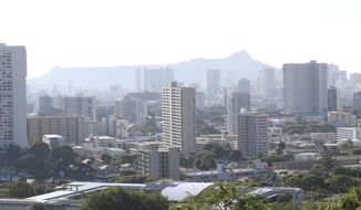 FILE - In this Jan. 13, 2018 file photo, Diamond Head, an extinct volcanic crater, and high-rises are seen in Honolulu. Gov. David Ige has appointed state Army National Guard Brig. Gen. Kenneth Hara as new head of Hawaii's emergency management agency after a faulty alert was sent to cellphones around the state warning of an incoming missile attack. (AP Photo/Audrey McAvoy, file)