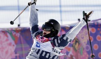 FILE - In this Feb. 13, 2014, file photo, Gus Kenworthy, of the United States, celebrates at the end of his second run in the men's ski slopestyle final at the Rosa Khutor Extreme Park at the 2014 Winter Olympics in Krasnaya Polyana, Russia. Kenworthy's life has changed, and unlike most athletes who make it big at the Olympics, it's only partly because of the medal he won. His supposedly perfect stay in Russia was something much less, however, mainly because of the secret he kept. He was gay but would not tell the world for almost another two years. (AP Photo/Andy Wong, File)