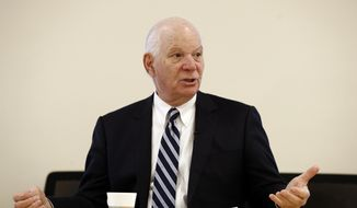 Sen. Ben Cardin, D-Md., right, poses for a photo after speaking with members of the Downtown Partnership of Baltimore in Baltimore, Tuesday, Jan. 16, 2018. (AP Photo/Patrick Semansky) ** FILE **