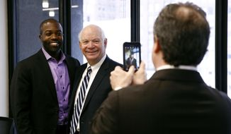 Sen. Ben Cardin, D-Md., center, poses for a photo with Delali Dzirasa after speaking with members of the Downtown Partnership of Baltimore in Baltimore, Tuesday, Jan. 16, 2018. Cardin, who has served two terms in the U.S. Senate, is facing a Democratic challenger after Chelsea Manning, the transgender former Army intelligence analyst who was convicted of leaking classified documents, confirmed via Twitter on Sunday her intention to run in the 2018 Maryland Democratic primary. (AP Photo/Patrick Semansky)