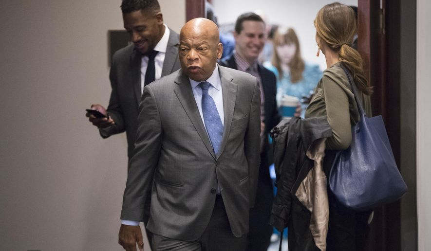 FILE- In this Nov. 29, 2017, file photo, Rep. John Lewis, D-Ga., and other members of the House Democratic Caucus leave a meeting on Capitol Hill in Washington. Lewis will speak at the Mississippi Civil Rights Museum, months after refusing to join President Donald Trump there.A private group called Friends of Mississippi Civil Rights Inc. announced Tuesday, Jan. 16, 2018, that it will give an award to Lewis, who helped lead the historic 1965 march across the Edmund Pettus Bridge in Selma, Ala. (AP Photo/J. Scott Applewhite, File)